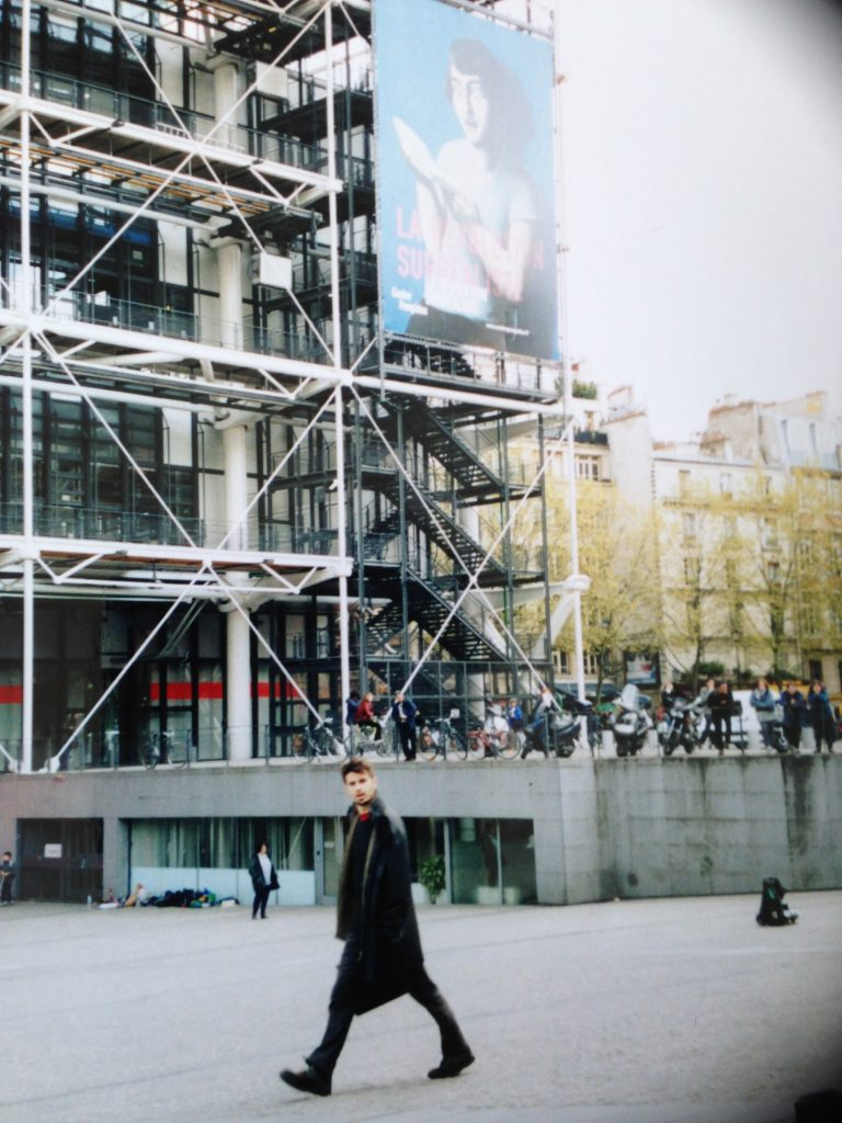 Pompidou Centre, taken around May 2010. Not sure who the curious young man is.